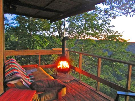 wood burning stove sleeping deck   trees fire pit
