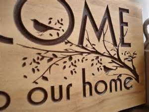 carved wooden welcome sign nature inspired by