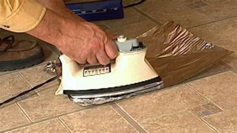 How To Fix Vinyl by Fix Curling Vinyl Floor Tiles With A Clothes Iron