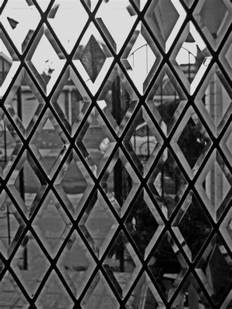 diamond pattern wall mirror through the glass door wallcandy w a l l c a n d