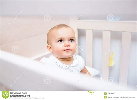 Looking For A Baby Crib Closeup Of A Baby Looking Up In Crib Stock Photo