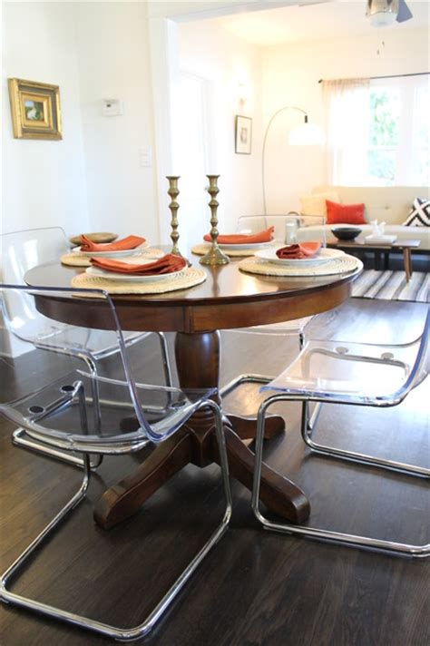 Clear Dining Room Table Clear Acrylic Dining Chairs Paired With Traditional Pedestal Table Eclectic Dining Room