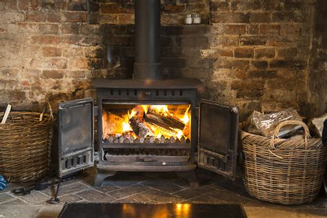 Log Fireplace by Cottages
