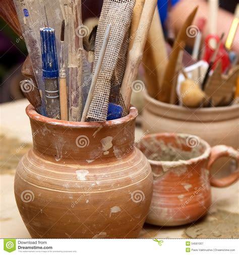 Handmade Clay Pots - handmade clay pots with pencils stock photo image