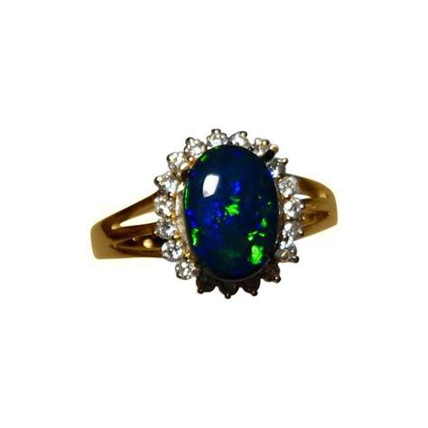 black opal ring with 21 diamonds flashopal