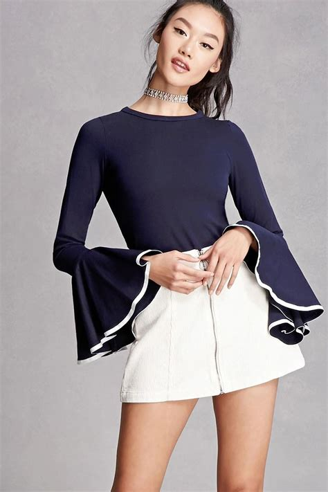 Contrast Trim Sleeve Knit Top a stretch knit top featuring trumpet sleeves with