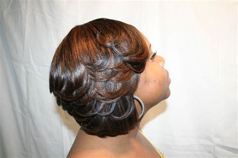 pics of bump feather sew in sew in weave bob hairstyles this is a feathered a line