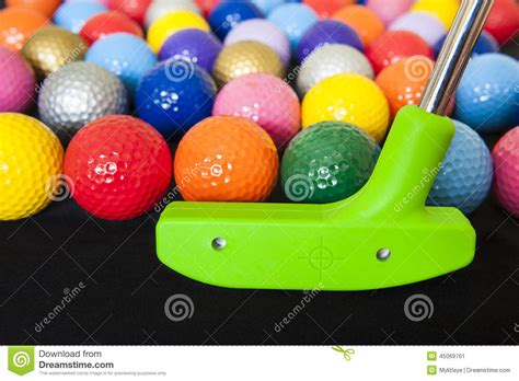 colorful golf colorful golf balls with green club stock photo image