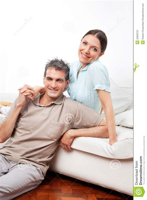couple on couch happy couple on couch in living royalty free stock
