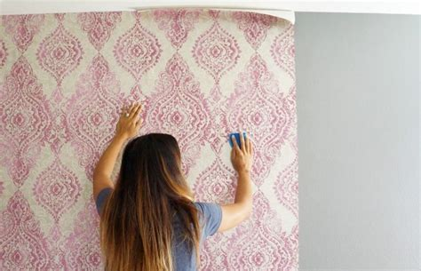 putting up patterned wallpaper how to hang wallpaper with a pattern diy inspired