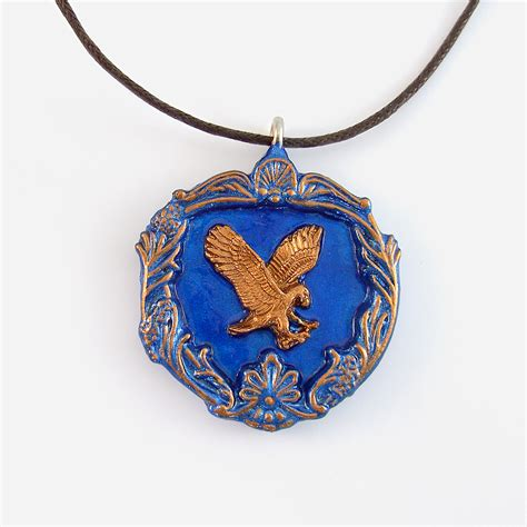 ravenclaw house crest pendant and brown cord necklace on