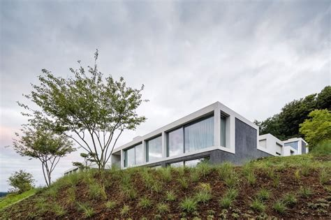 Identical Houses Built On The Hill By Think Architecture | identical houses built on the hill by think architecture