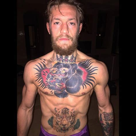 conor mcgregor tattoo pics conor mcgregor s chest tattoo of a gorilla king eating