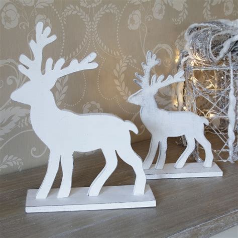 pair of white wooden reindeer melody maison 174
