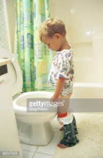 Boy And In The Bathroom by Boy Using The Bathroom Stock Photo Getty Images