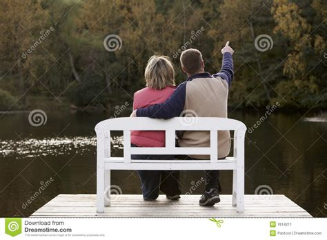 couple sitting on bench couple sitting on a bench stock image image 7614211