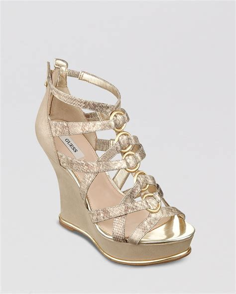 guess wedge shoes lyst guess platform wedge sandals barran in metallic
