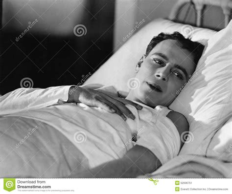 man in bed portrait of injured man in bed stock photo image 52006751