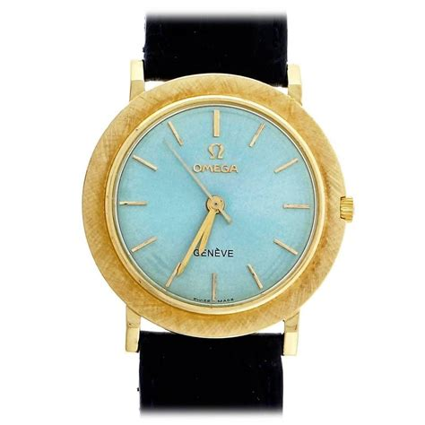 omega yellow gold custom colored blue wristwatch