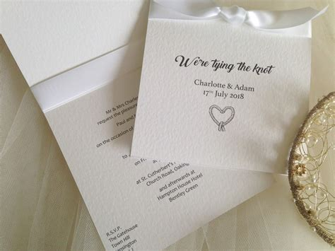 tying ribbon for wedding invitations tying the knot wedding invitations wedding invites