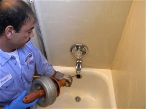 cleaning out bathtub drain snake plumbing george salet plumbing