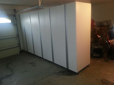 dual garage ports with cabinet wall c l design