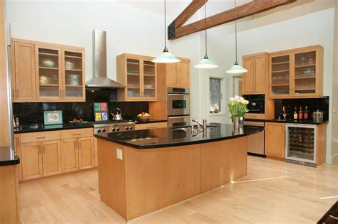 kitchens with light maple cabinets modern kitchen with dark granite and light maple cabinets