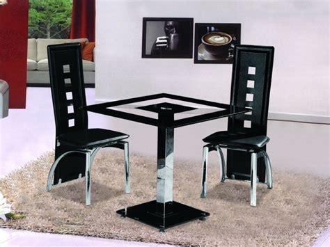 small white dining table and 2 chairs