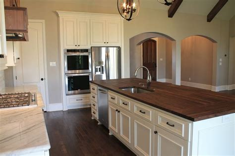 white cabinets with butcher block top white marble and stained butcher block counter tops with