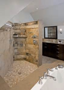 Shower featuring island stone floor and border with slate stone tile