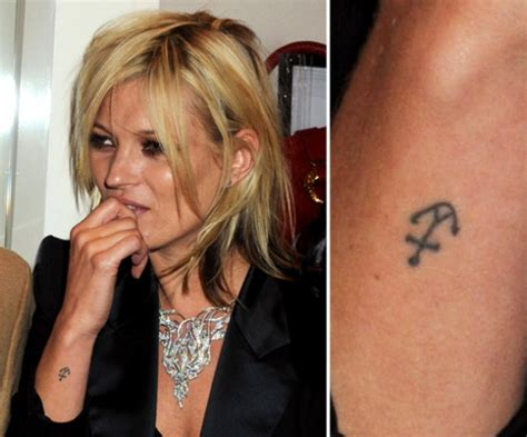 kate moss tattoo of anchor heart birds
