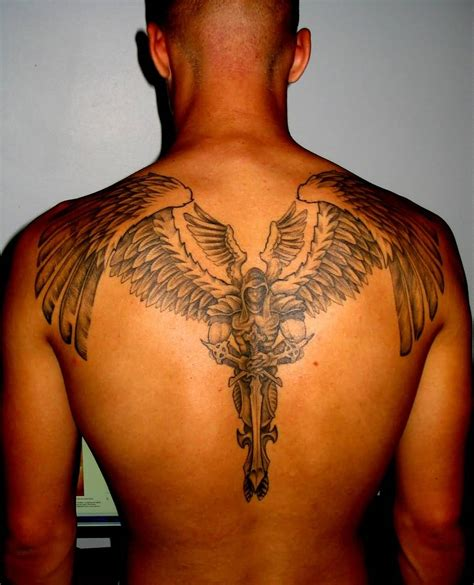 angel tattoo at the back 21 guardian angel tattoos on back