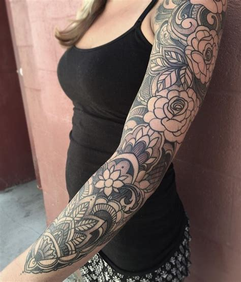 jade tattoo ornamental black and gray floral sleeve in progress by