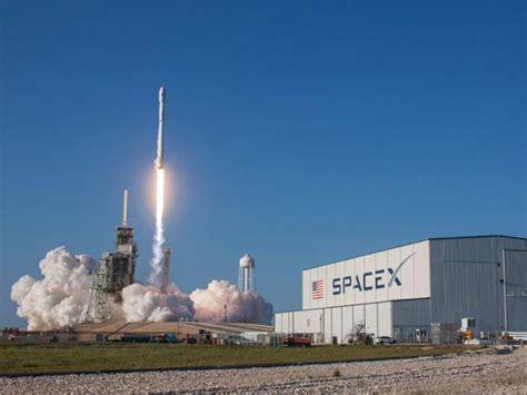 elon musk rocket launch tesla s elon musk spacex rocket re launch makes history