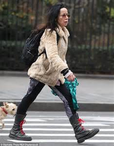 janeane garofalo wrapped up in furry coat and black combat