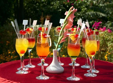 Cocktail Party Themes - cocktails on the red table at outdoor party stock photo colourbox