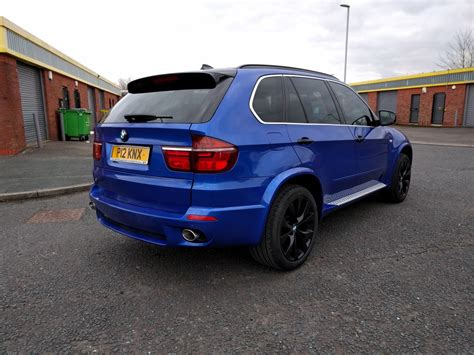 light blue bmw x5 bmw x5 full vinyl wrap in 3m gloss metallic blue