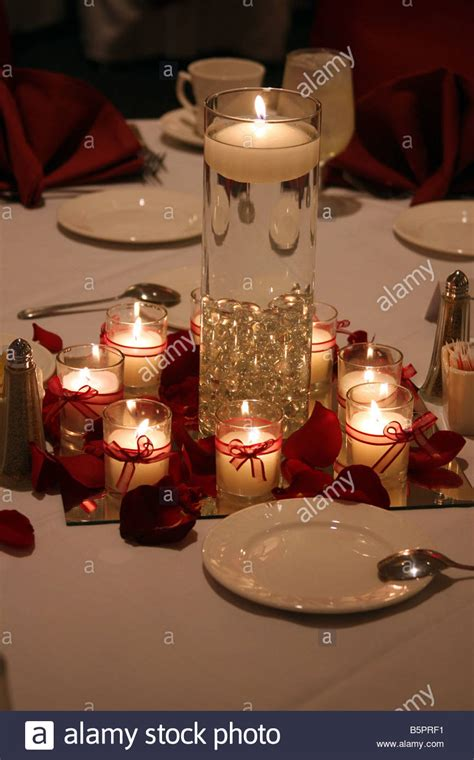 Burning Candles And A Floating Candle In A Vase As The Where To Buy Vases For Wedding Centerpieces