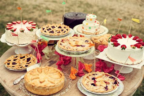 variety of wedding cakes a variety of pies and cakes are unified by mini flags