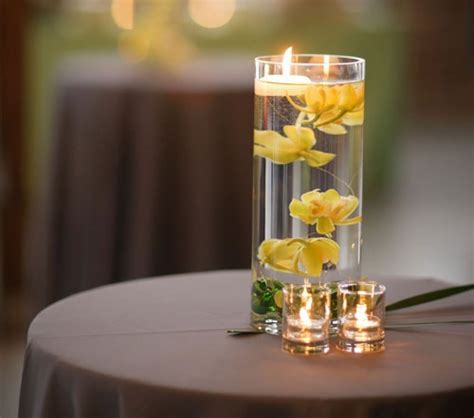 Candle Vase Centerpiece Ideas by 17 Best Ideas About Submerged Flower Centerpieces On