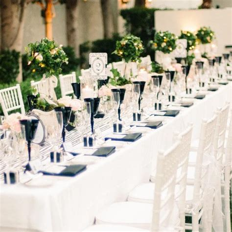 sleek and sophisticated black and white wedding reception