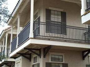 contemporary metal iron vertical balcony railing fence cream painted wall white small pillars