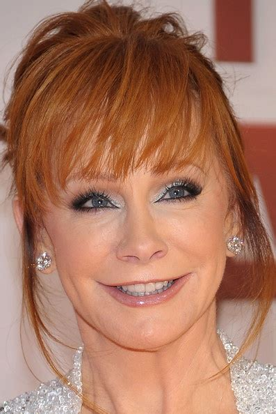 updo for 50 yr olds reba mcentire bobby pinned updo her hair wispy bangs