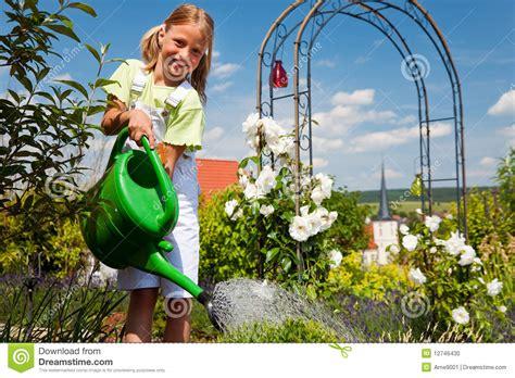 girl watering flowers little girl watering flowers stock photo image 12746430