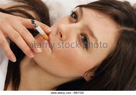 smoking in bed woman smoking on bed stock photos woman smoking on bed stock images alamy
