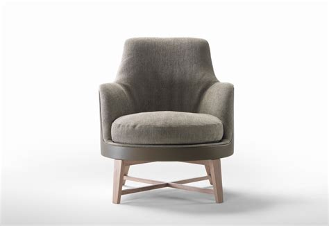 soft armchair guscioalto soft armchair wooden foot stand by flexform