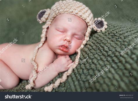 closeup of beautiful baby with flower headband stock photo closeup beautiful sleeping baby newborn stock photo