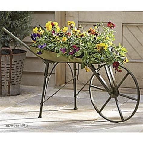 Rustic Wheelbarrow Planter by Rustic Metal Wheelbarrow Porch Or Patio Planter Wagon