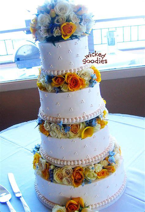 white wedding cake  fresh flowers