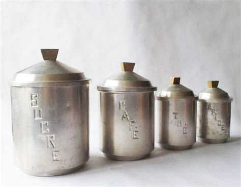 set of 4 vintage kitchen canisters white metal